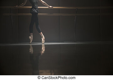 Ballet dancer's body - Ballerina standing on pointes. She...
