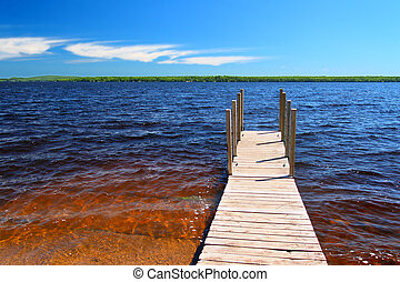 Lake Gogebic Boat Launch - Wooden pier and choppy waters of...