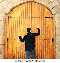 Teen knocking door - Teen knocking wooden old door in Cyprus...