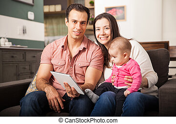 Happy family using technology at home - Portrait of a...