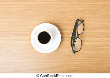 coffee cup and eyeglasses