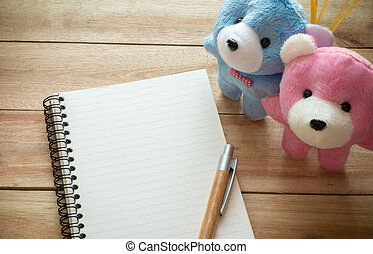 Blank notebook with copy space and pencil,couple teddy put...