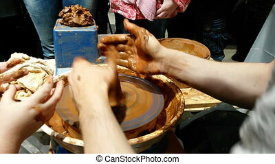 Potter works - Hand of potter making clay pot