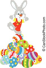 Easter Bunny - A little grey rabbit on top of a pile of...