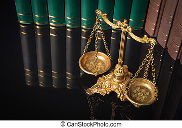 golden justice scales in front of law books