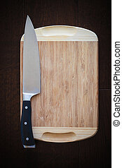 8 inch chef's knife on a cutting board, ready to cook...