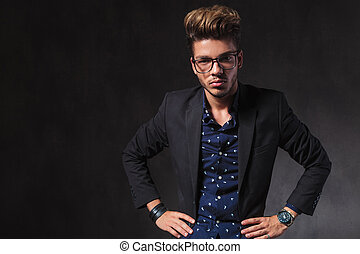 inteligent handsome man wearing glasses pose in dark studio...