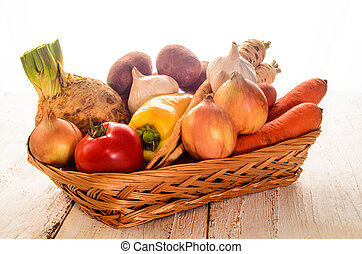 basket with fresh vegetables on wihte rustic table -...