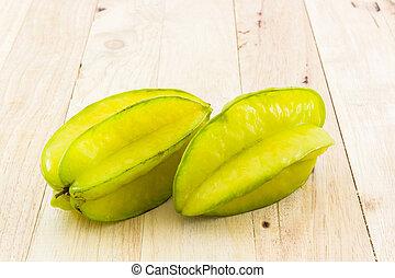 Star fruit or Carambola - Star fruit or Carambola on wood...