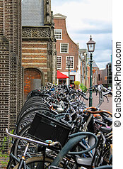 Parked bicycles on the street in the historic center of...