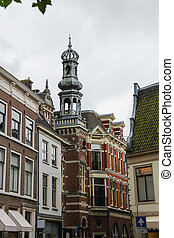 Old tower with a spire in the historic center of Haarlem, the Netherlands