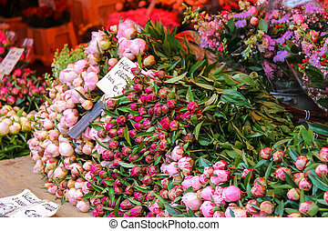 Street flower shop with colourful tulip bouquets