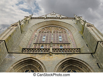 Facade of the Grote Kerk (Sint-Bavokerk) in the historic...