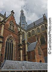 The bell tower of the Grote Kerk (Sint-Bavokerk) in the...