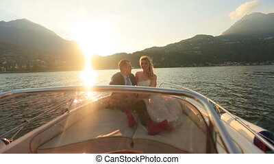 Lovers Lying and Kissing in the Boat Sunset Bright at the...
