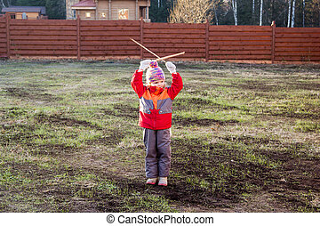 little girl gives signals with wooden sticks - little girl...