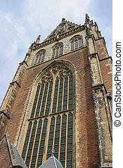 Facade of the Grote Kerk Sint-Bavokerk in the historic...