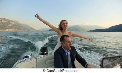 Lovers Driving the Boat on the Lake Como With Background of...