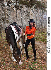 Young Woman And Horse - Young woman and horse in a forest