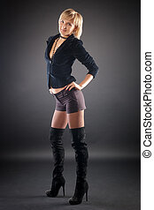 sexual blond woman in short skirt .