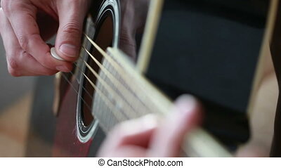 man playing on black guitar. mediator - man playing on black...