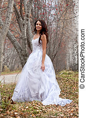 Young Bride In A Forest - Young woman wearing a wedding...