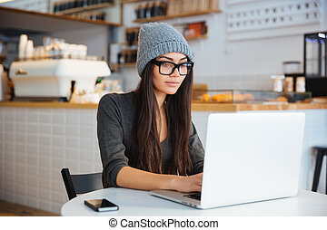 Woman using laptop computer in cafe - Fashion woman using...