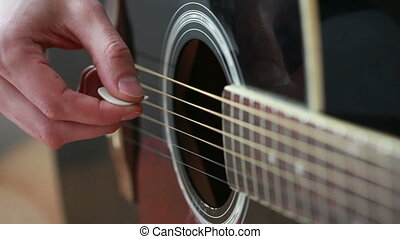 man playing on black guitar mediator - man playing on black...
