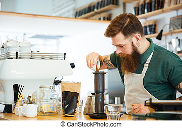 Barista making coffee in coffee shop
