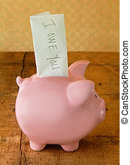 Piggy Bank with IOU Note - Piggy bank with an IOU note...