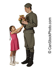 Little girl gives bunch of flowers to Soviet soldier