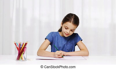 happy girl drawing with colour pencils at home - people,...
