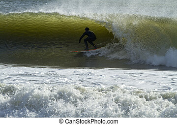 Wave Rider - Surfer riding a wave during huge eastcoast...