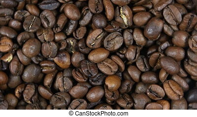 Background of the rotating coffee beans closeup