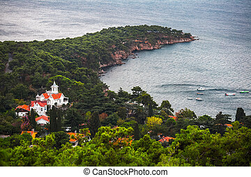 Turkey - Rocky cape with forest of one of the Prince Islands...