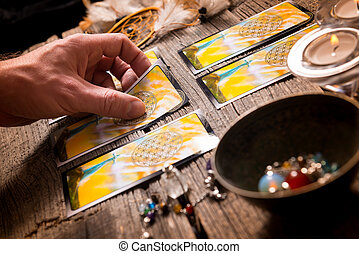 Hand with tarot cards - Fortune teller holding a tarot card
