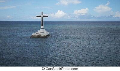 Catholic cross in the sea. - Sunken Cemetery cross in...