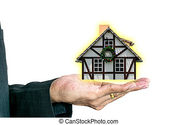 Home model in hand of young businessman.