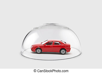 Car protected under a glass dome