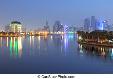 Sharjah City skyline at dusk. United Arab Emriates