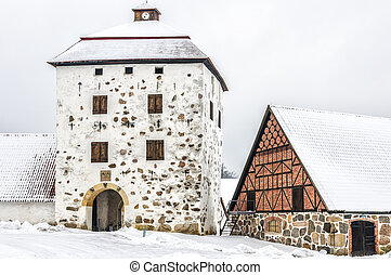 Hovdala Castle Gatehouse in Winter - View of a snow covered...