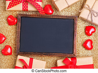 black board and hearts on a table