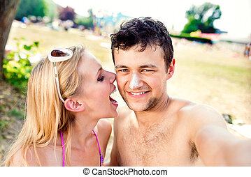 Beautiful couple on the beach - Beautiful young couple...