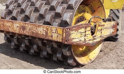 Huge road roller with spikes is com