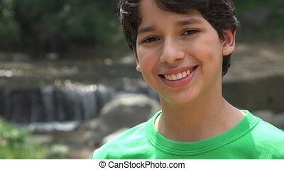 Teen Boy Smiling near Cascade
