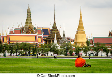 Bangkok, Bhuddist monk sitting in Sanam Luang park with Wat...