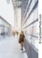 abstract image of woman in town in the rush hour of a modern...
