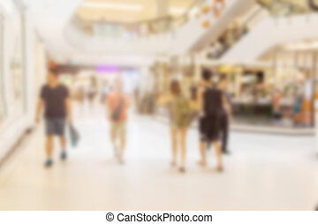 abstract image of people in the lobby in the rush hour of a...