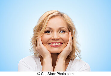 smiling woman in white t-shirt touching her face - beauty,...