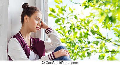 sad pretty teenage girl sitting on windowsill - people,...
